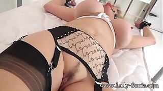 British mature Lady Sonia gagged and bound to the bed